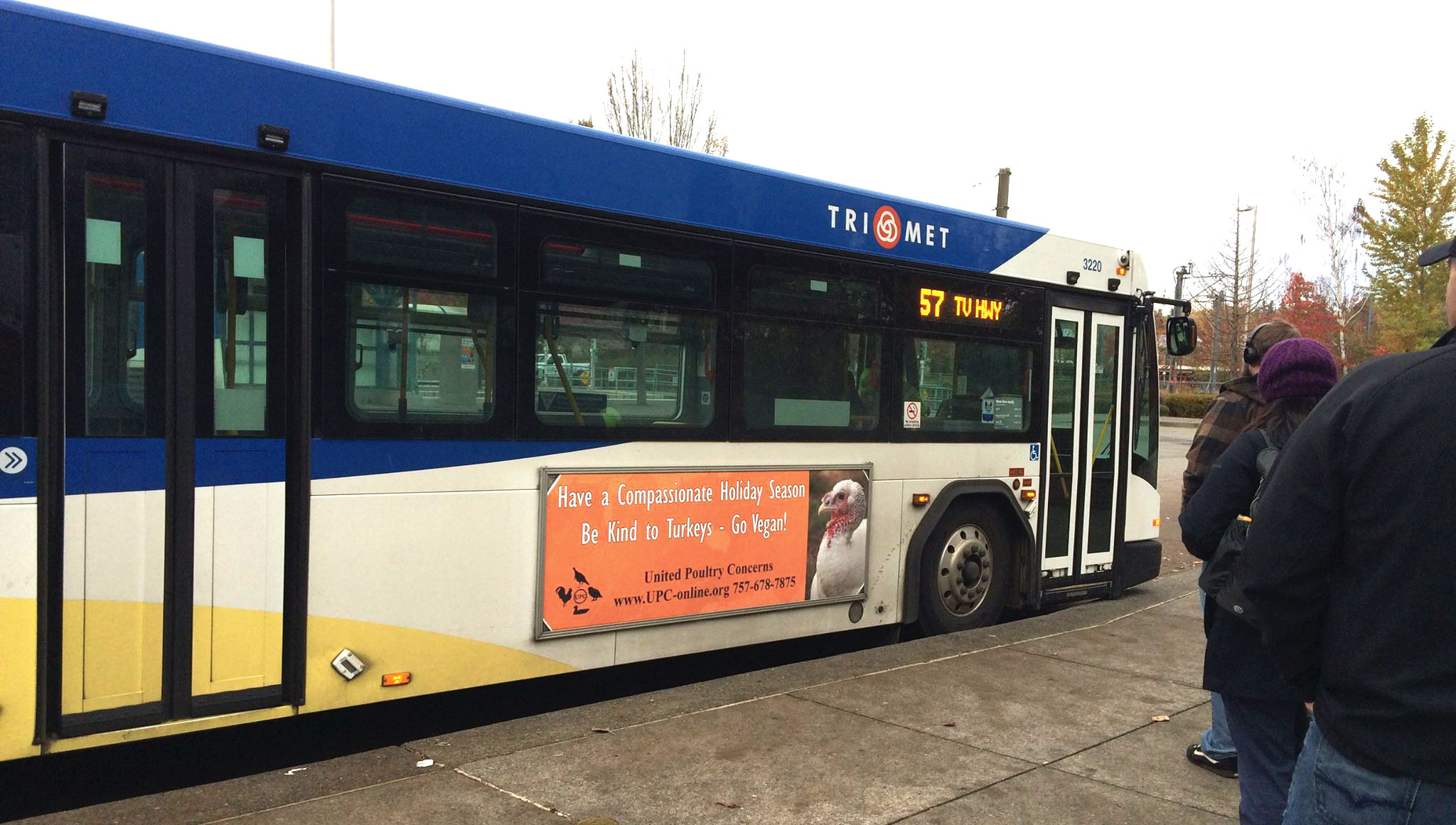 Bus sign: Have a Compassionate Holidy Season. Be Kind to Turkeys - Go Vegan!.