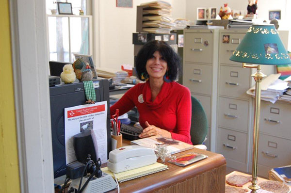 Karen Davis at her desk